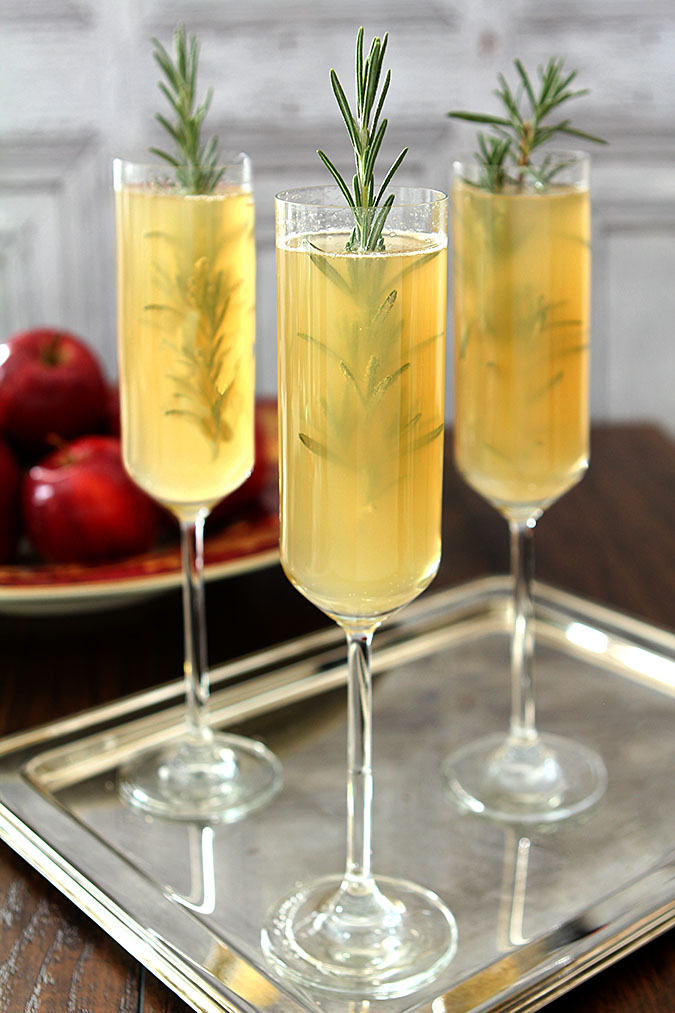 Apple Cider Bellini Cocktail with Rosemary Cocktail Served on a Silver Tray