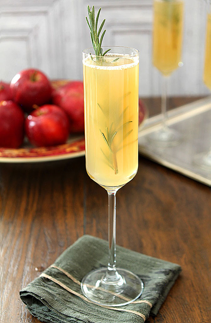 Apple Cider Bellini Cocktail with Rosemary in a Champagne Glass