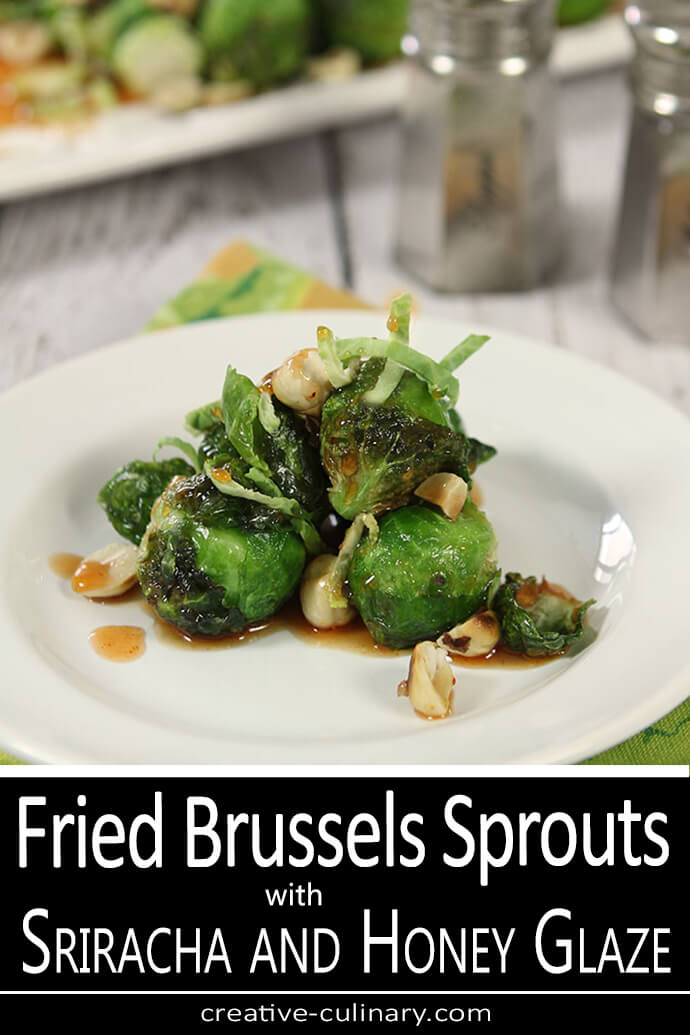 Fried Brussels Sprouts with a Sriracha Honey Glaze Served on a White Plate