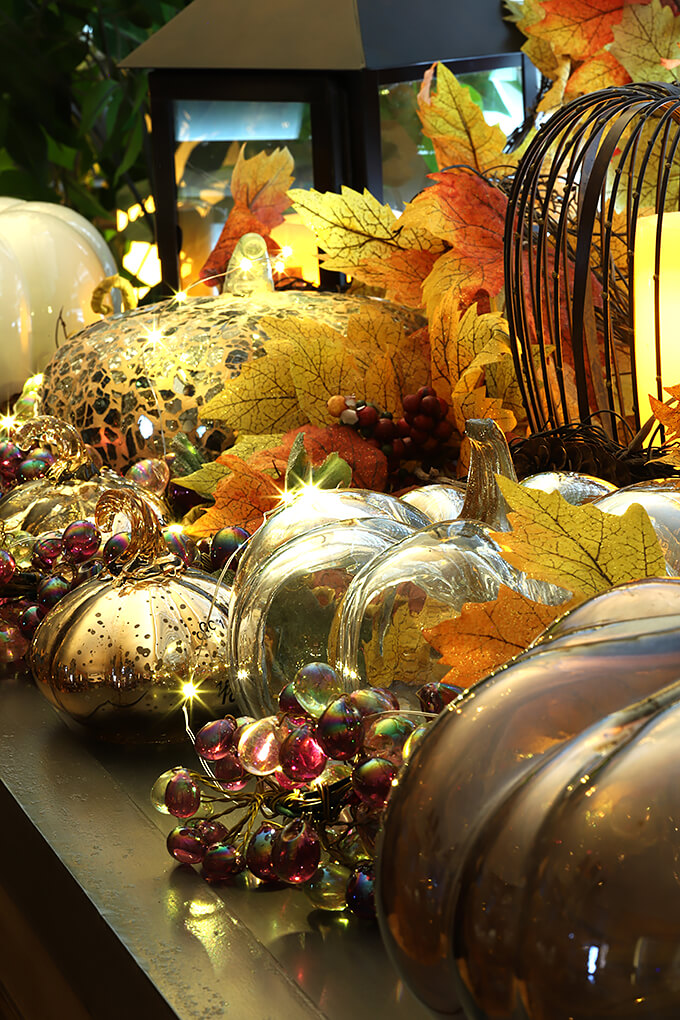 Glass and Ceramic Fall Pumpkins on Buffet Table