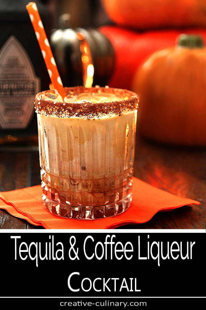 Tequila, Kahlua, and Cream Cocktail Served in a Lowball Glass with Orange Straw for Halloween