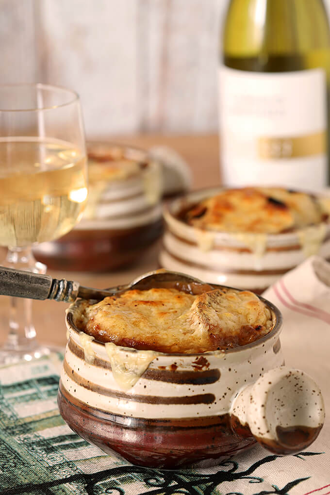 The UItimate French Onion Soup in Table Setting with Three Soups Bowls