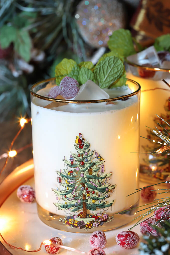 White Chocolate Mint Eggnog Cocktail Closeup in Gold Rimmed Glass with Spode Christmas Tree