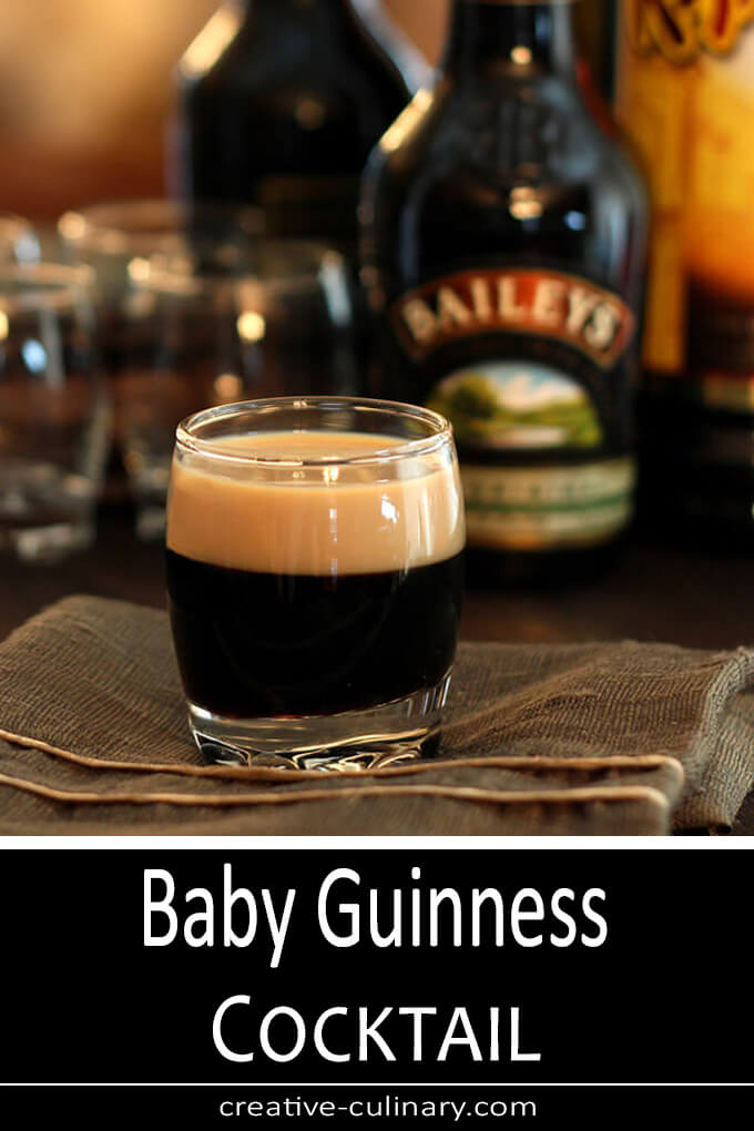 Coffee Liqueur and Bailley's are stacked to create this Baby Guinness cocktail; looks like a miniature beer!