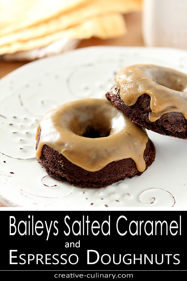 Two Baileys Salted Caramel and Espresso Doughnuts stacked on a white plate.