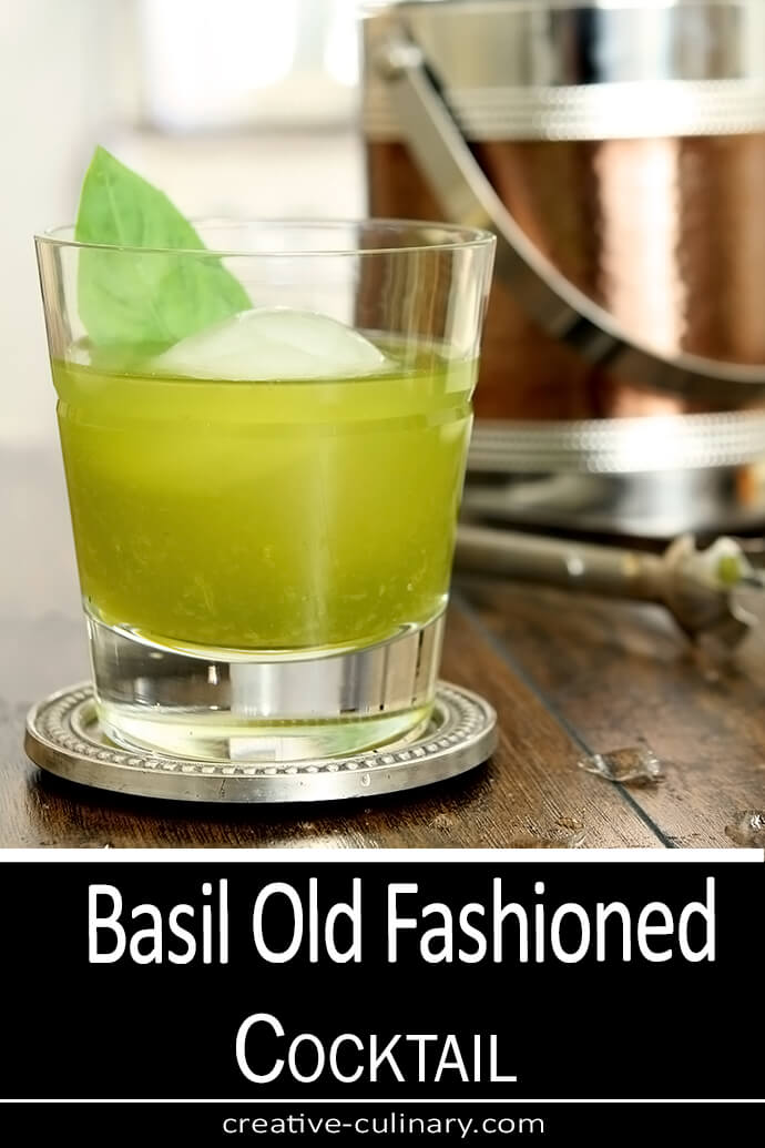 Basil Old Fashioned Cocktail in a lowball glass with a large round ice cube