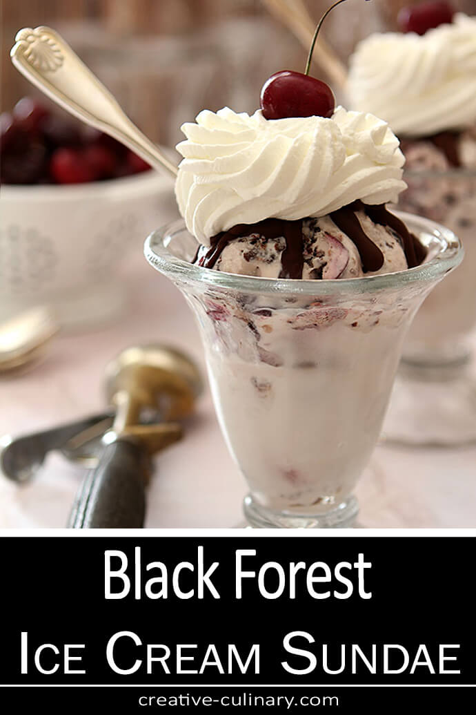Black Forest Ice Cream Sundae with Chocolate and Cherries in an Old Fashioned Sundae Glass.