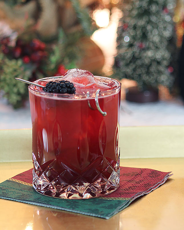 Blackberry Collins Cocktail with St. Germain Liqueur on a Burgundy and Forest Green Napkin