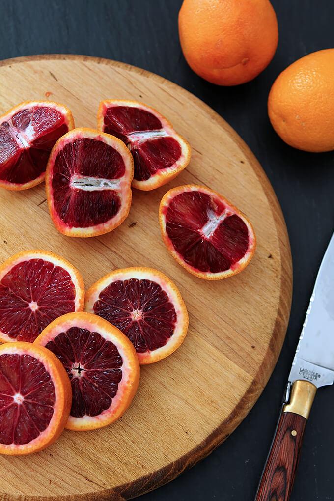 Blood Oranges Cut Open on Wood Cutting Board