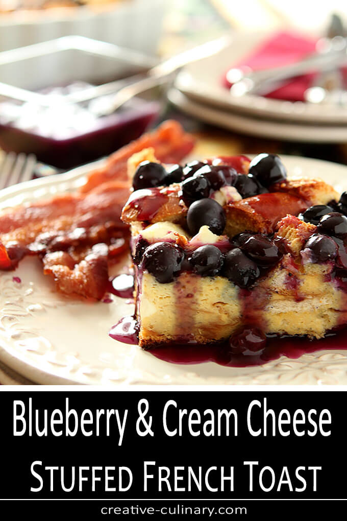 Blueberry and Cream Cheese Stuffed French Toast Served with Bacon on a White Plate