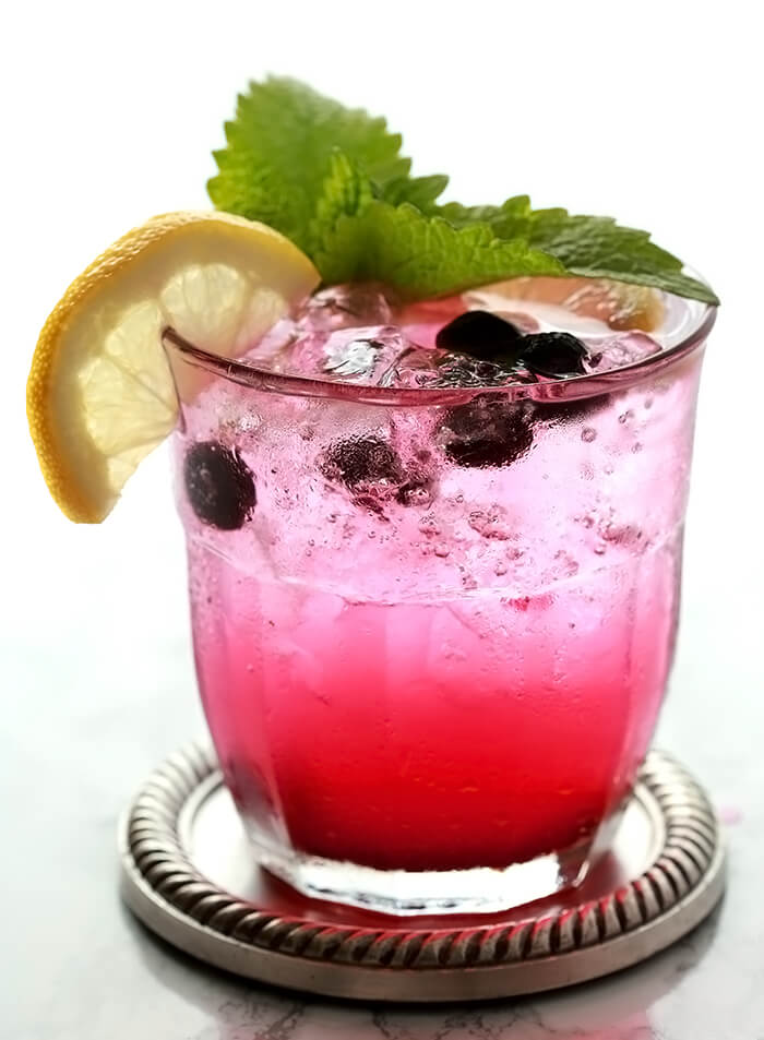 Closeup of a single Sparkling Lemonade and Blueberry Cocktail
