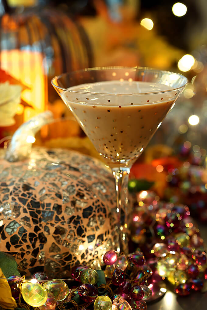Bourbon Cocktail with Pumpkin and Chocolate Liqueur Served in a Martini Glass with Gold Polk-a-dots