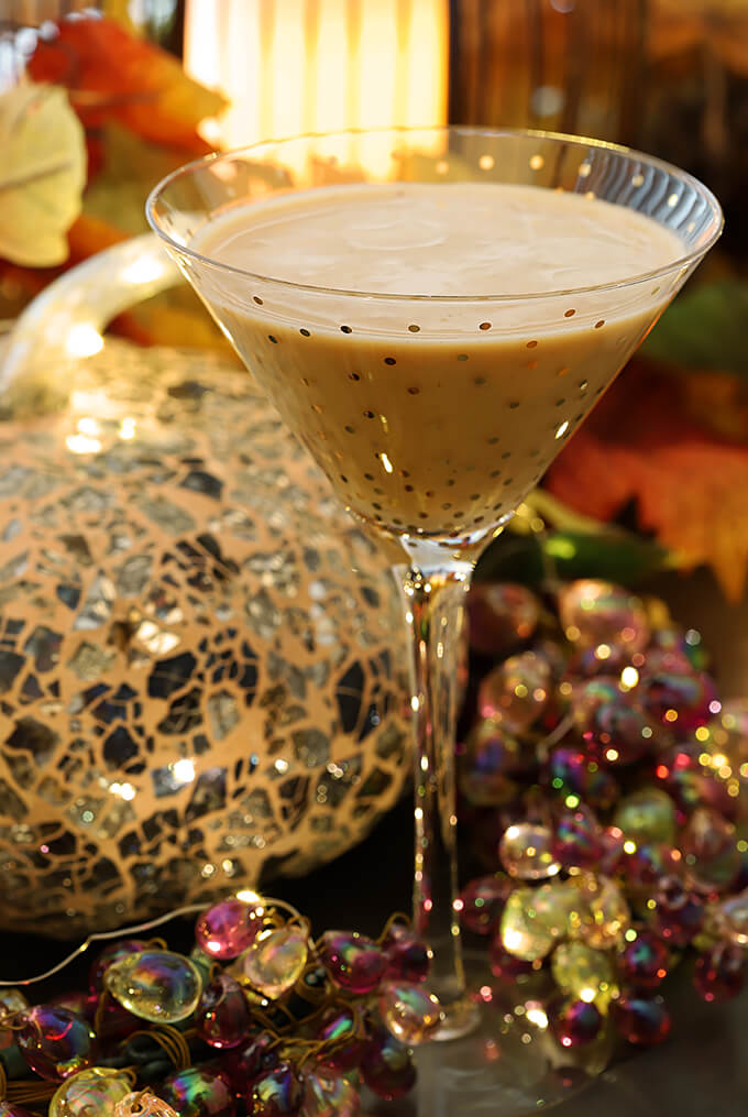 Bourbon Cocktail with Pumpkin and Chocolate Liqueur on Table with Thanksgiving Decorations
