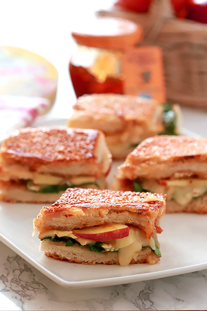 Brie, Apple, and Fig Grilled Cheese Sandwiches on a Rectangular Serving Plate