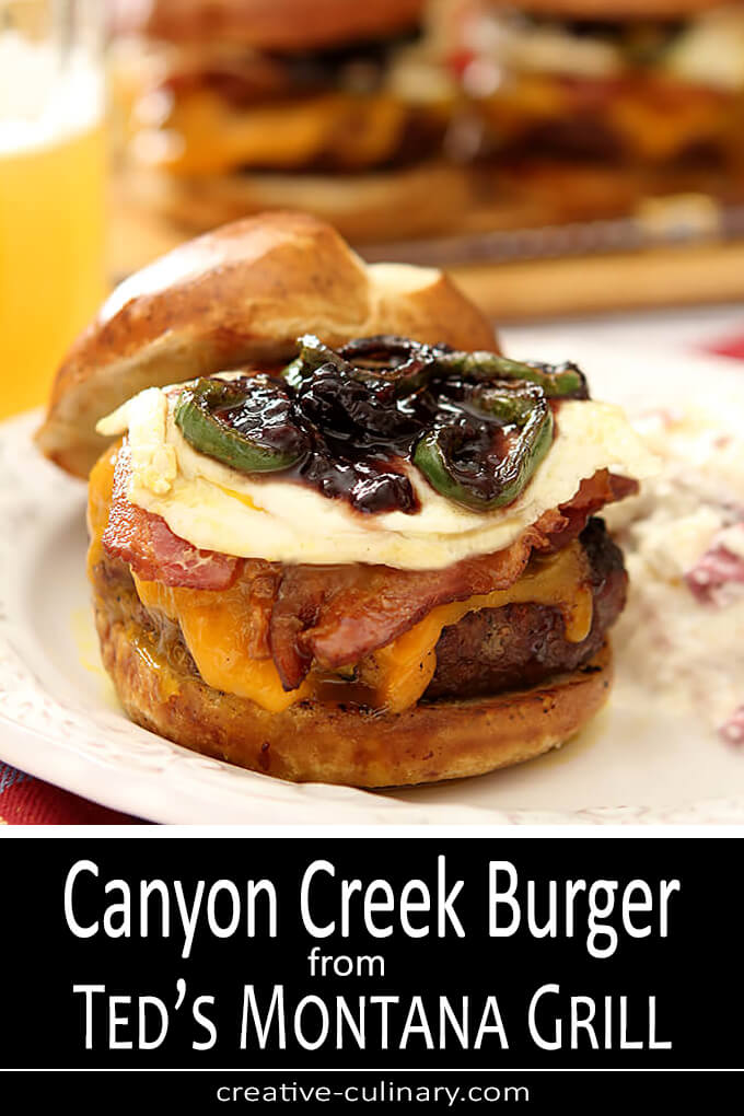 Canyon Creek Burger from Ted's Montana Grill Served with Cheese, Bacon, Fried Eggs, Jalapeno and Blackberry Ham on a Bun
