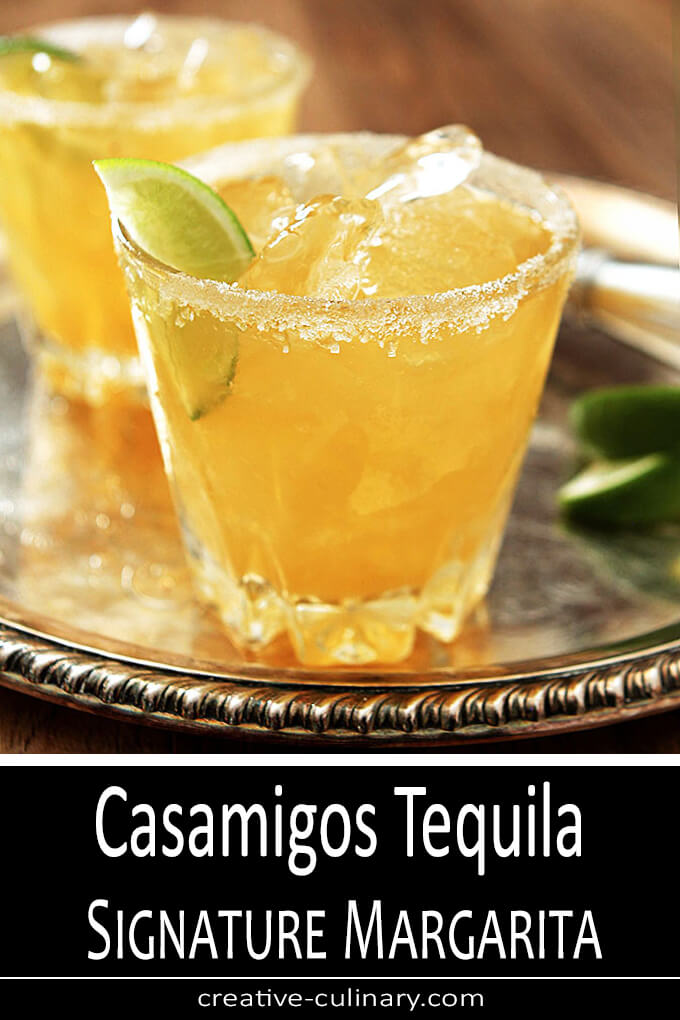 Casamigos Tequila Margarita Cocktail Served on a Silver Tray in a Short Glass with a Wedge of Lime.