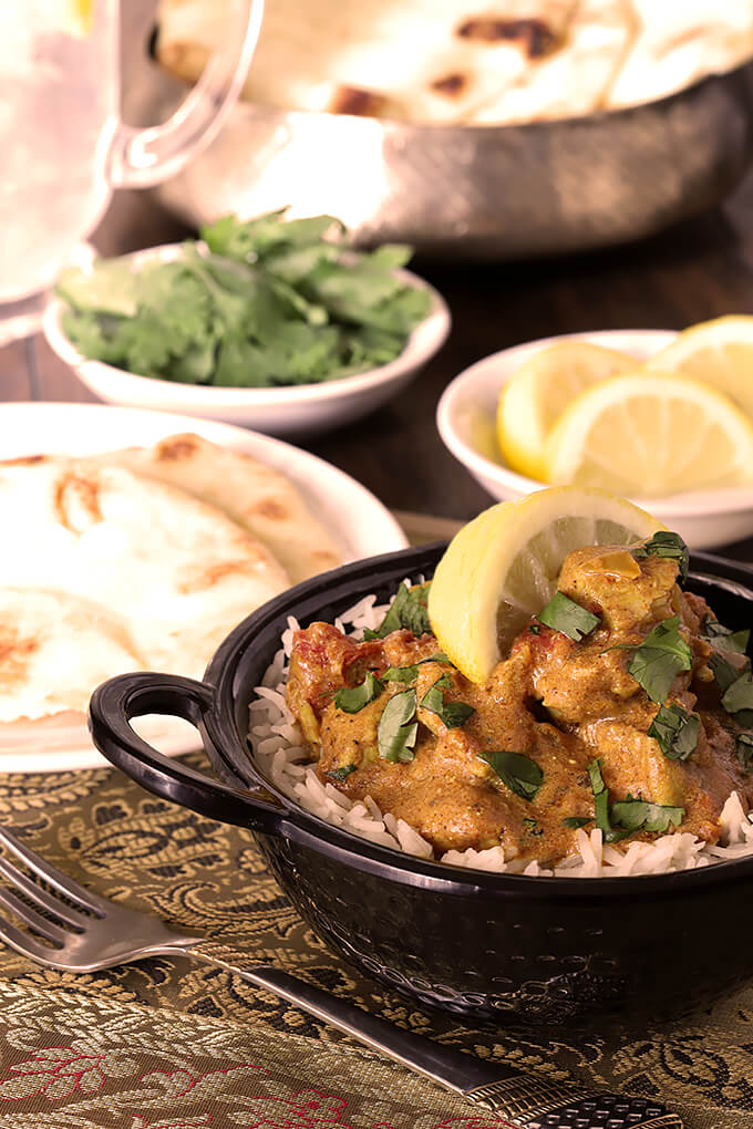 Easy Chicken Curry Garnished with Lemon