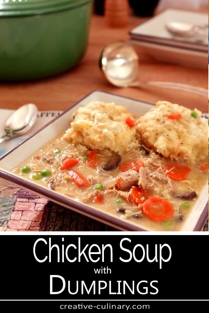 Old Fashioned Chicken Soup with Dumplings Served in a Square Bowl Filled with Carrots and Fluffy Dumplings
