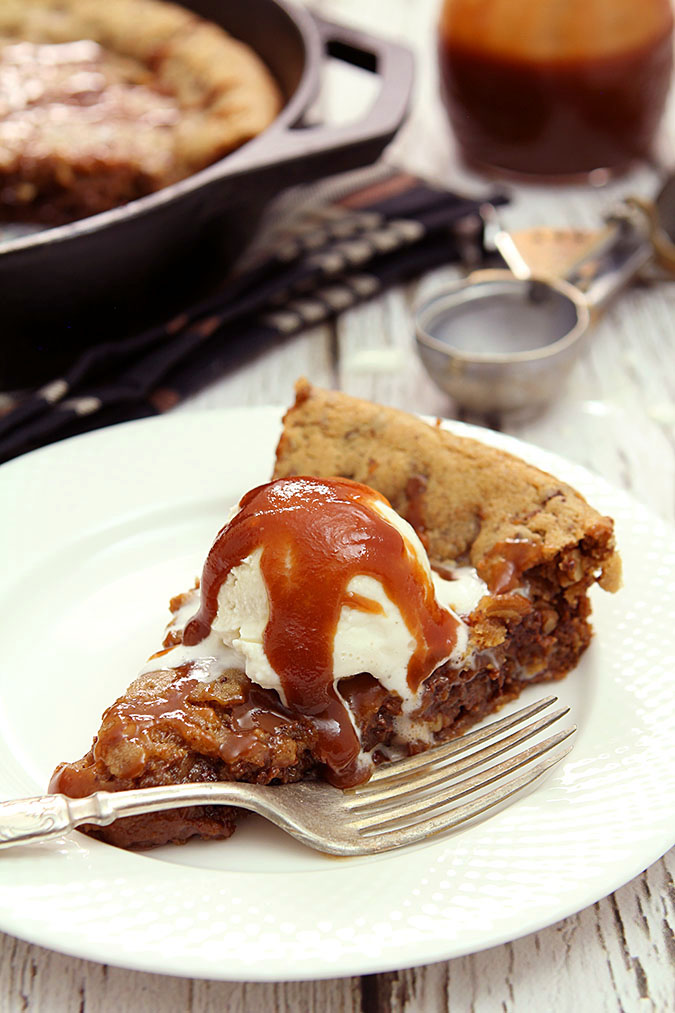 Chocolate Chip Skillet Cookie with Pecans & Bourbon Caramel Sauce