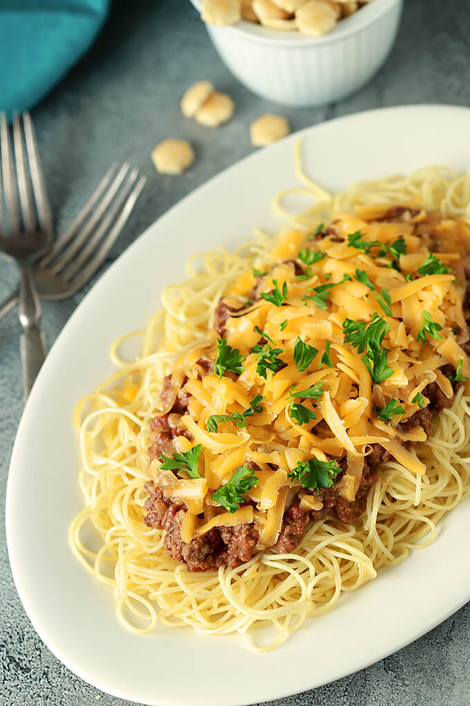 Cincinnati Chili with Cheese from above with a Bowl of Oyster Crackers