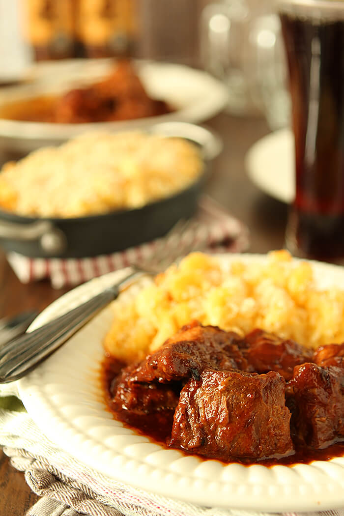 Country Pork Ribs with Bacon and Bourbon BBQ Sauce served with mac and cheese.