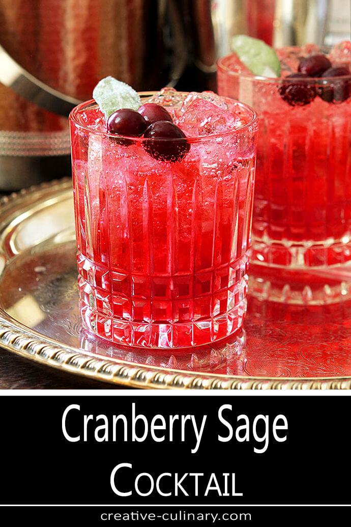 Cranberry Sage Cocktail Garnished with Fresh Cranberries and a Sage Leaf