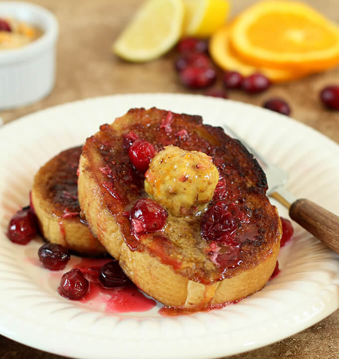 Cranberry Walnut Compound Butter Served with French Toast on a White Plate
