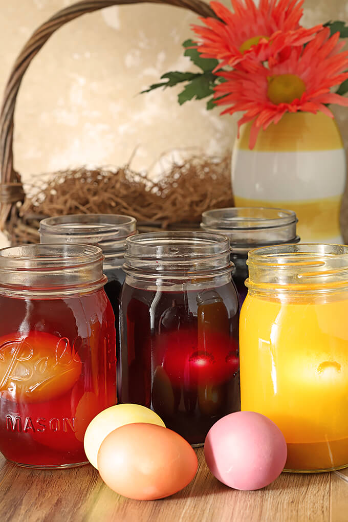Decorated Easter Eggs with Organic Soaking in Jars of Colored Liquid from Vegetables and Spices