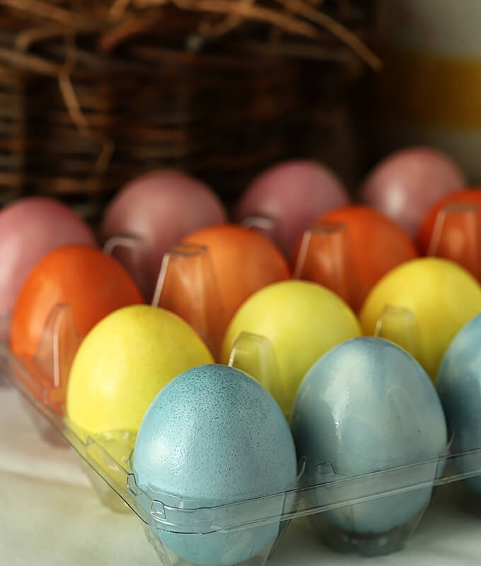 Decorated Easter Eggs with Organic Vegetables and Spices Stacked in an Egg Carton