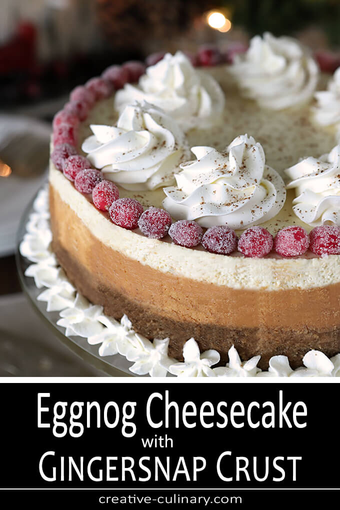 Eggnog Cheesecake with Gingersnap Crust Decorated with Sugared Cranberries and Whipped Cream
