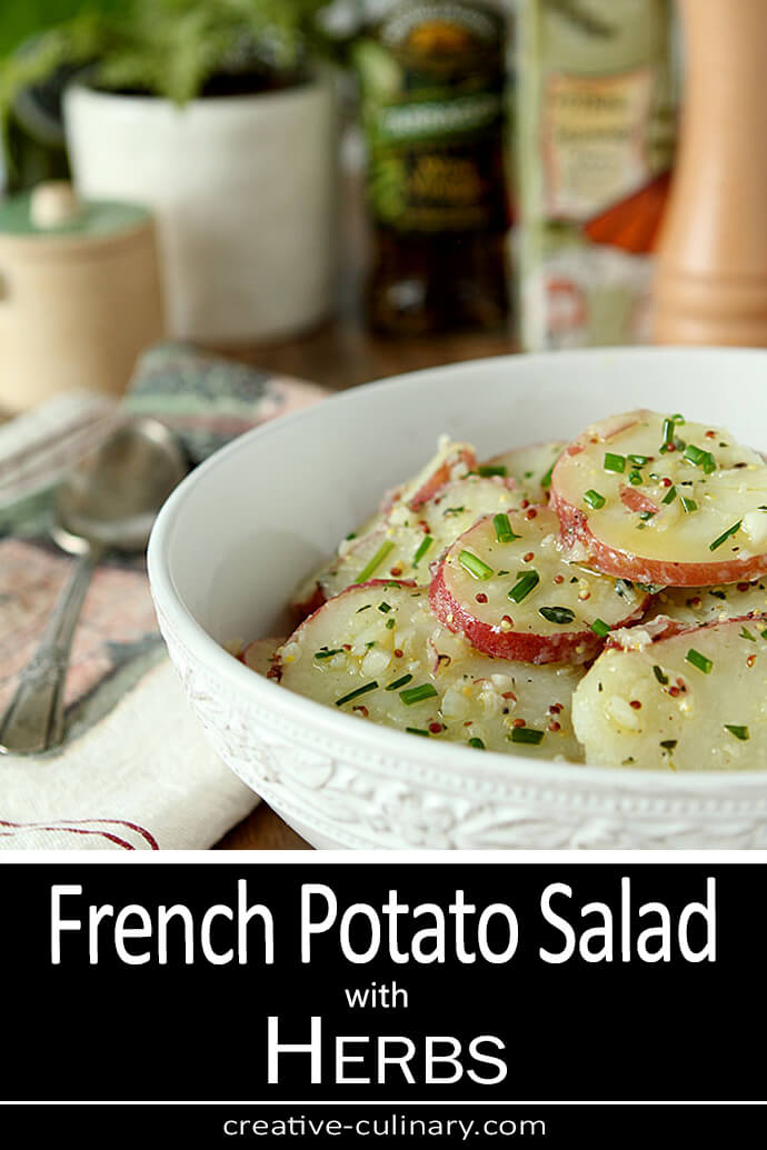 French Potato Salad with Herbs Served in a White Bowl