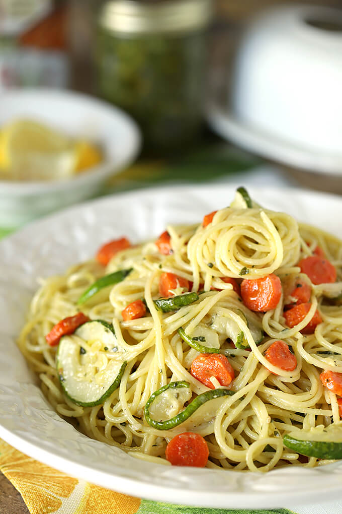 Garlic Pesto Pasta with Carrots and Zucchini in a White Serving Bowl