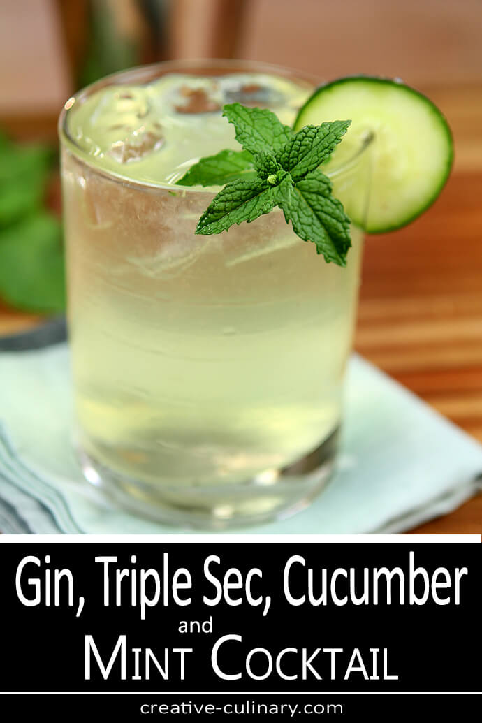 Gin, Triple Sec, Cucumber and Mint Cooler Served in a lowball glass and garnished with mint and cucumber.