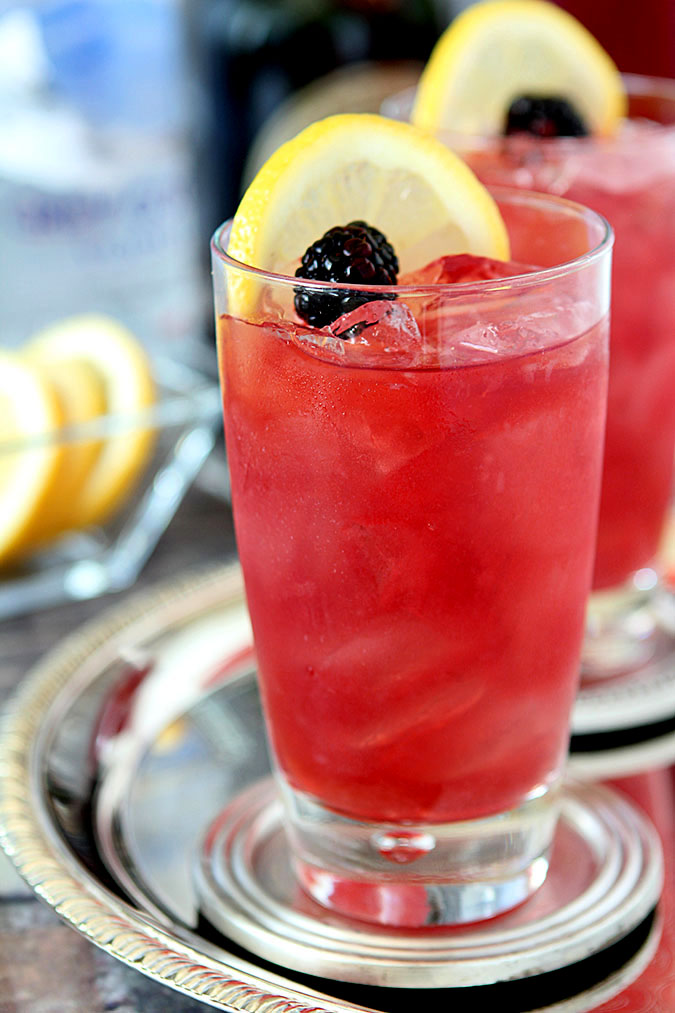 GREY GOOSE Kentucky Oaks Lily with Lemon and Blackberry Garnish