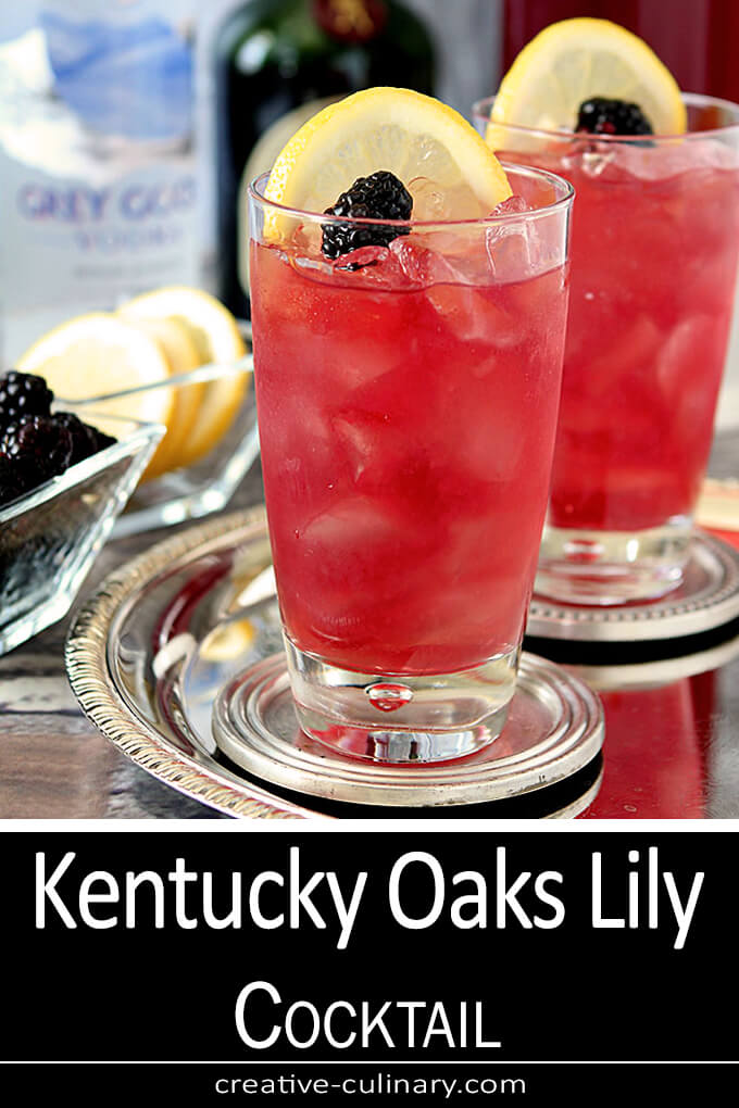 Kentucky Derby Oaks Lily Cocktail Served in a Tall Glass with Lemon and Blackberry Garnish