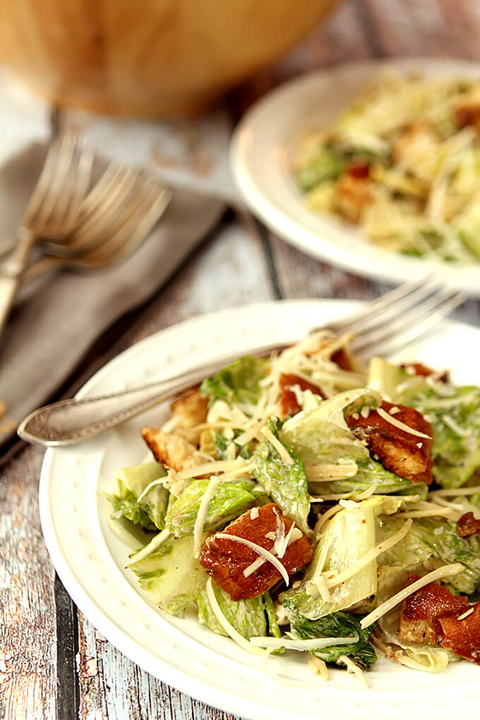 Grilled Caesar Salad with Homemade Croutons Served on a White Plate