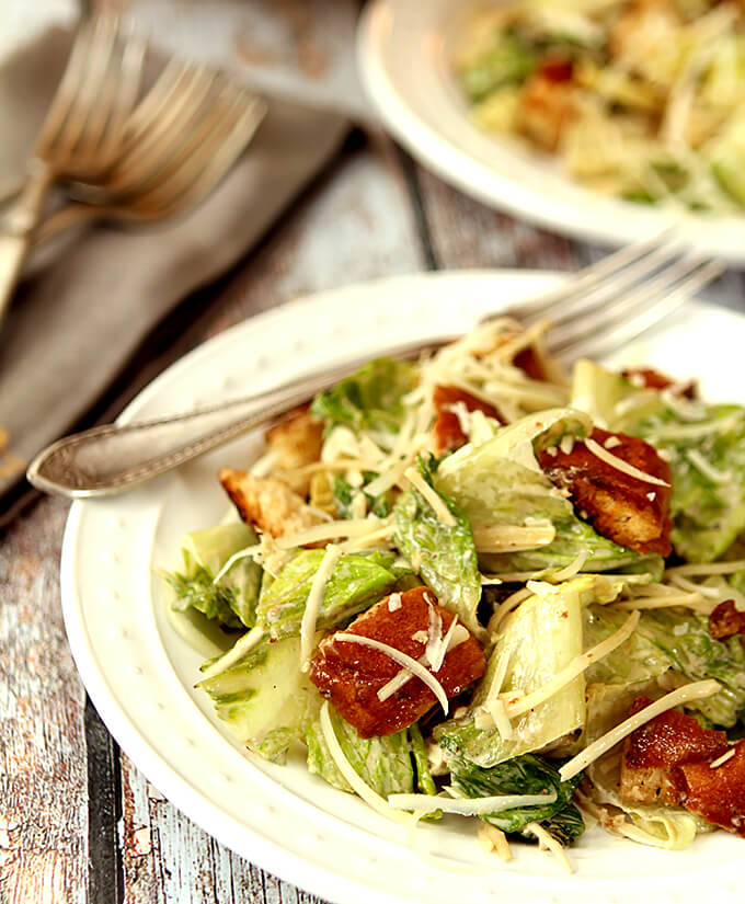 Grilled Caesar Salad with Homemade Croutons Served on Plates