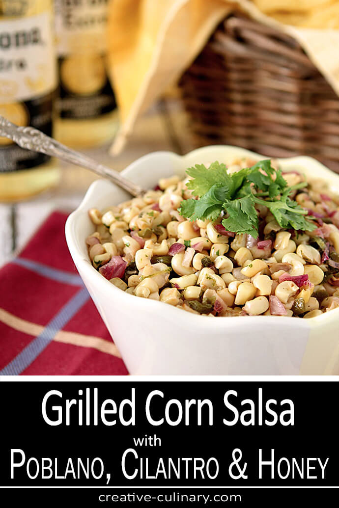 Grilled Corn Salsa with Poblano Chiles, Cilantro and Honey in a White Bowl Served with Tortilla Chips