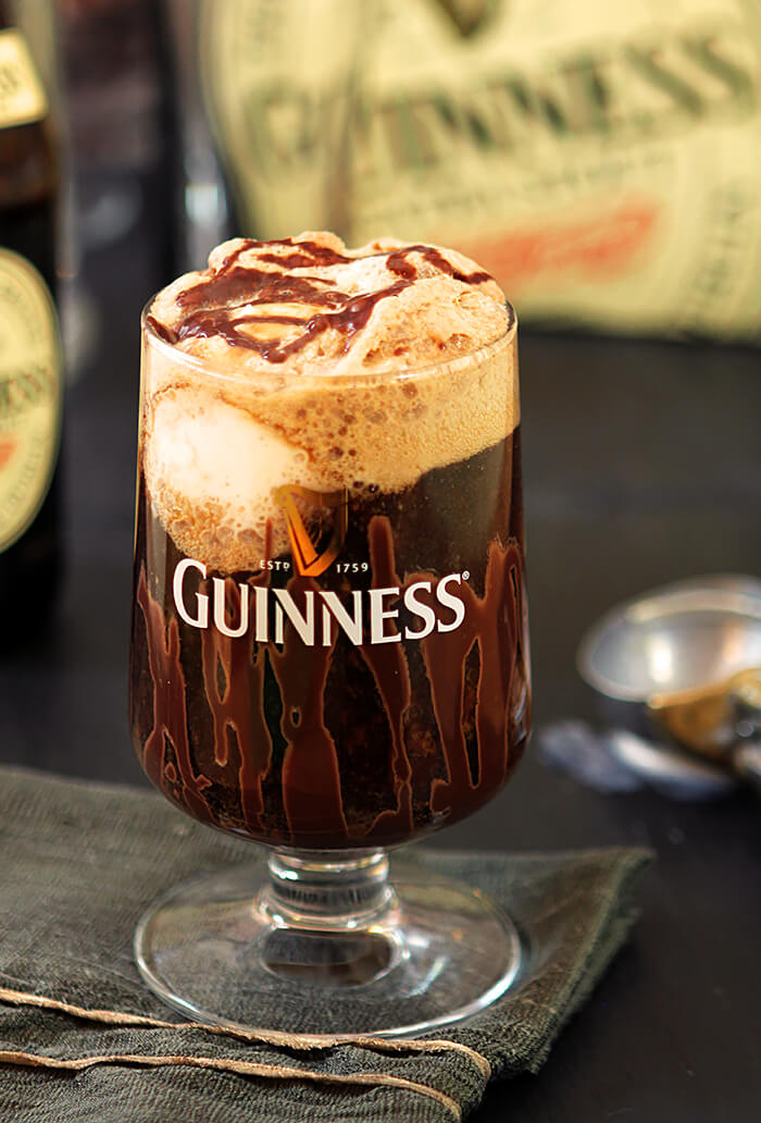 Guinness Float with Irish Cream Liqueur in a Guinness glass on a napkin
