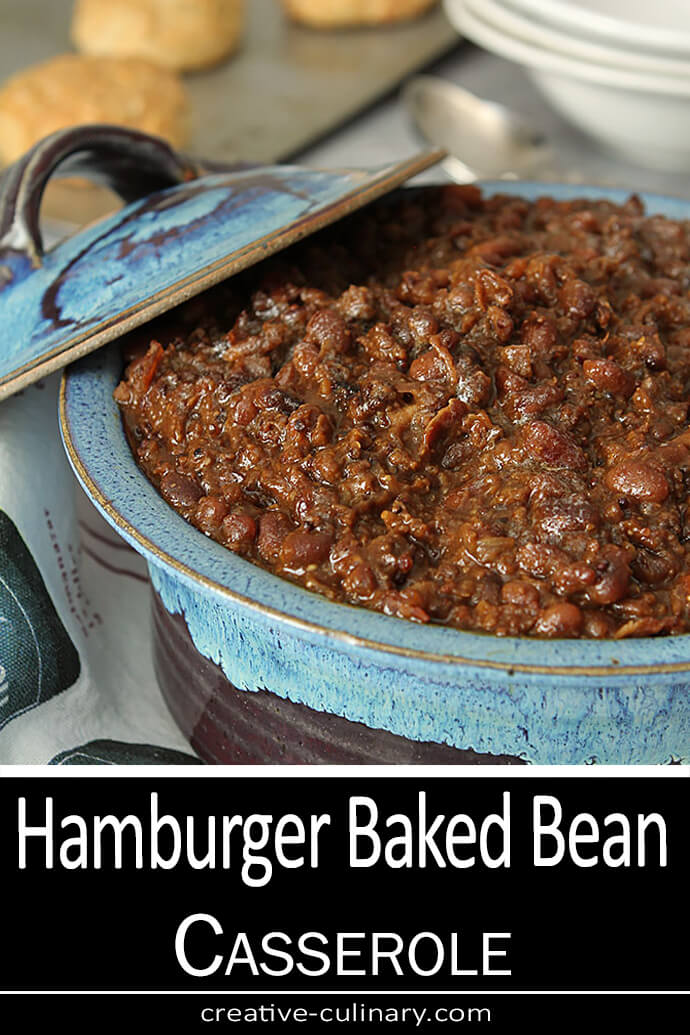 Hamburger Baked Bean Casserole Served in a Blue Pottery Dish