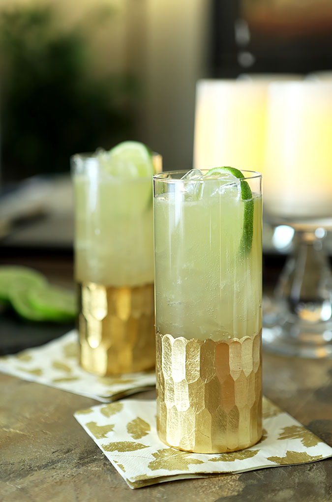 Honey Ginger Fizz Cocktail served in tall glasses with a lime slice.