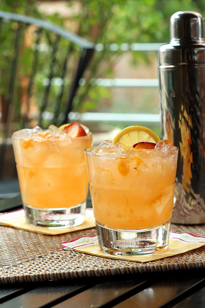 Kentucky Peach Bourbon and Vodka Cocktail Served in Two Glasses