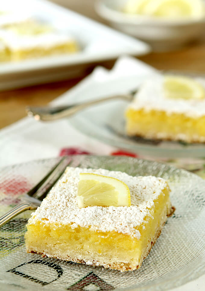 The Best Lemon Bars for A Crowd Served on a Glass Plate