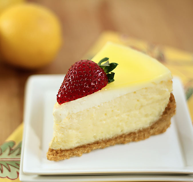 Luscious Lemon Cheesecake; one slice on a square white plate.