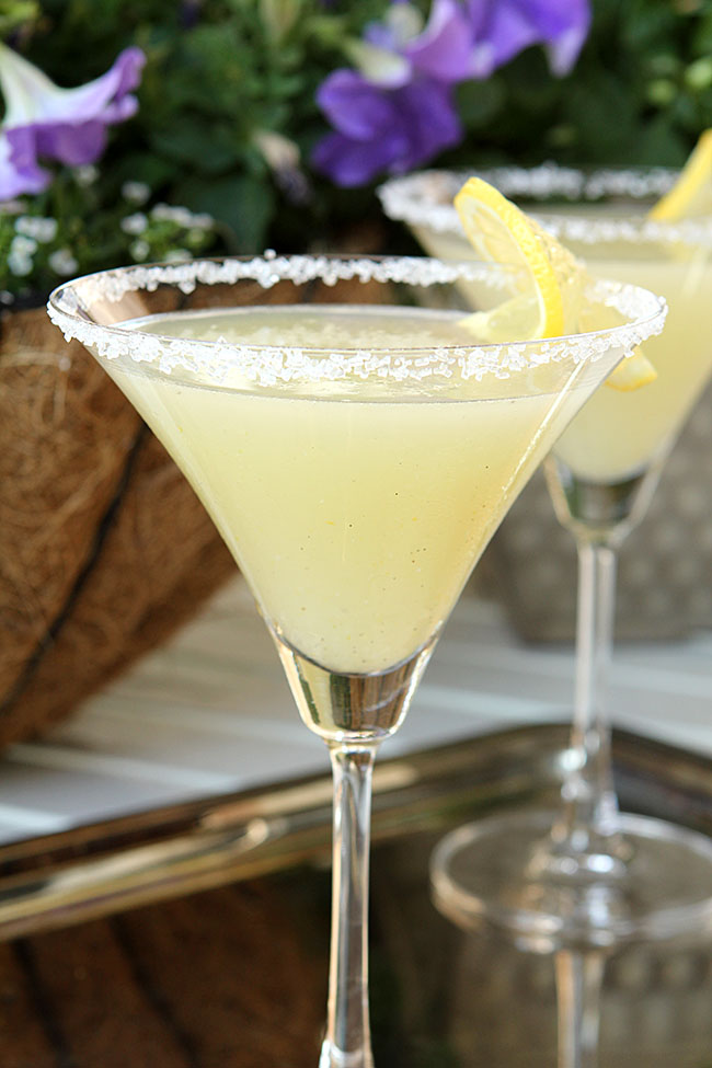 Shake well to make sure sugar is blended. Pour strained liquor into a sugar-rimmed martini glass and garnish with a twisted peel of lemon. NOTE: To create a sugar-rimmed glass, take a lemon wedge and rub the drinking surface of the glass so it is barely moist. Dip the edge of the glass into sugar/5().