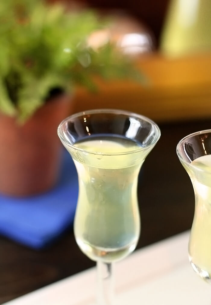 Homemade Limoncello Liqueur Served in a Small Liqueur Glass
