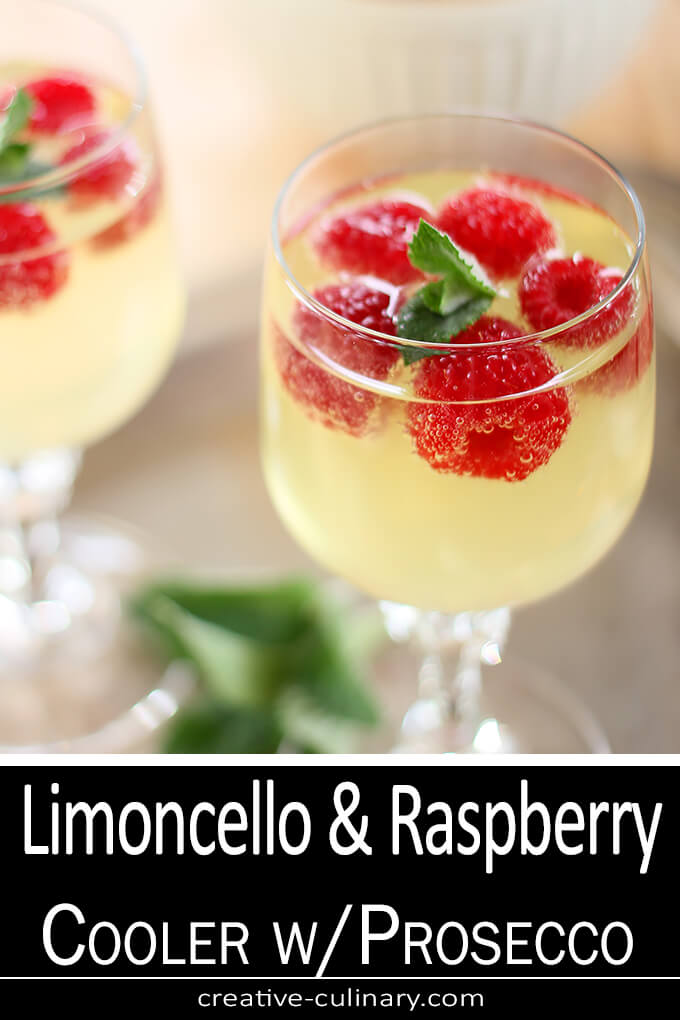 Raspberry, Limoncello and Prosecco Cooler Cocktail Served in a Wine Glass and Garnished with Raspberries and Mint