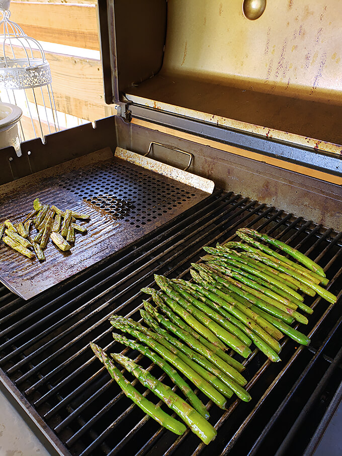 Grilled Asparagus with Garlic and Parmesan Grilling on an Outdoor Gril