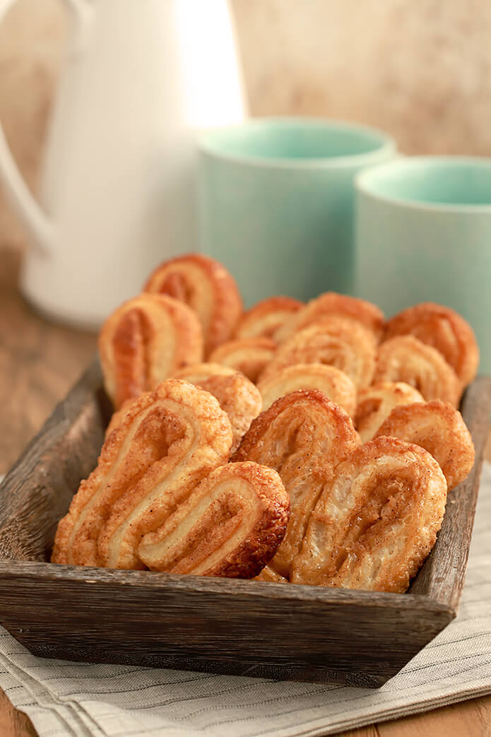 Orejas - A Mexican Pan Dulce in a Dark Brown Bread Basket
