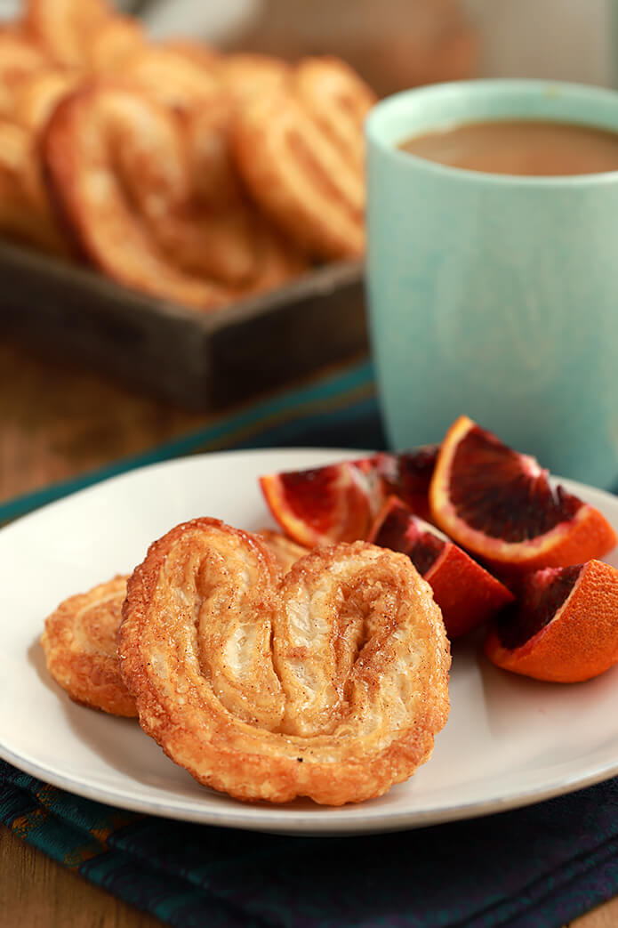 Orejas - A Mexican Pan Dulce Served on a Plate with Blood Oranges